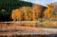 A pair of fly fisherman in the Clark Fork River along Maclay Flats on a fine fall day