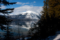 Mount Vaught framed by trees as seen from the east shore of Lake McDonald - Glacier National Park
