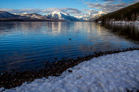 A view of the foot of Lake McDonald - Glacier National Park, with Stanton Mountain, Mount Vaught, Mount Brown and Little Matterhorn.