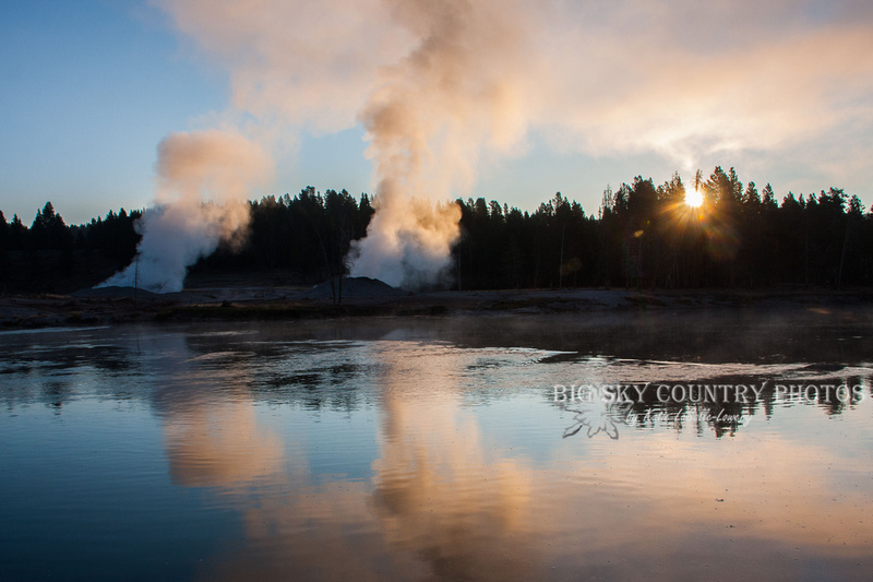 The light of the rising sun caught in plums of steam from vents along the Yellowstone River as it meanders through the Hayden Valley