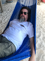 man lounging in a hammock